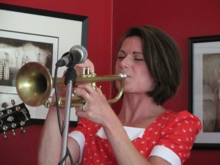 """Emily on trumpet during """"It takes alot to laugh, it takes a train to cry"""""""