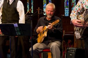 Playing mandolin in the Capital Gospel Show.